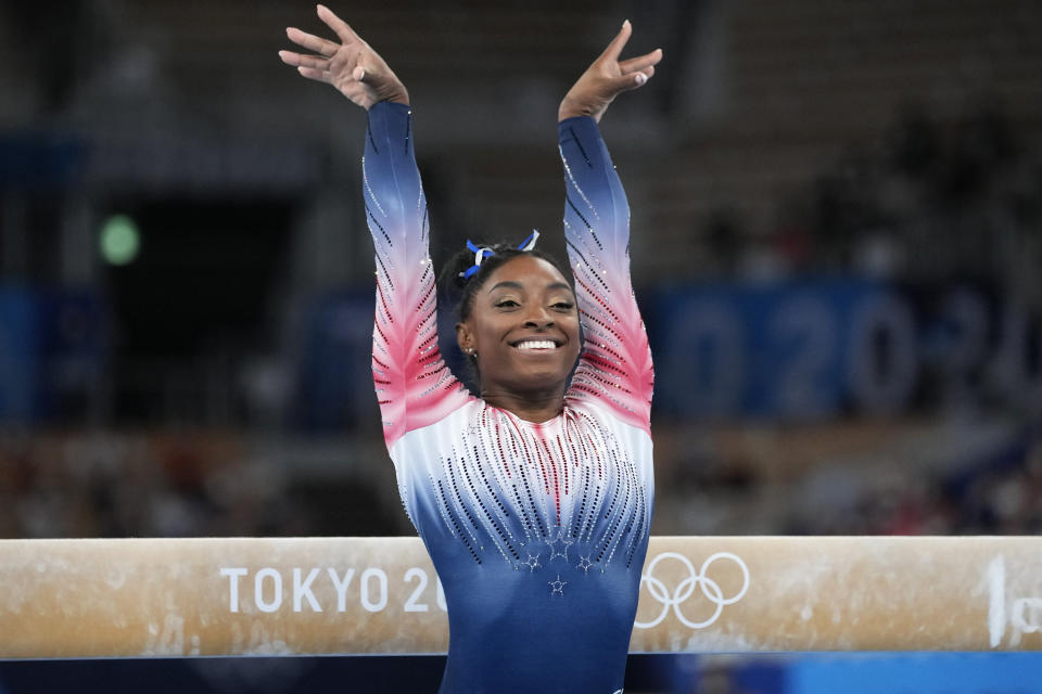 Simone Biles, of the United States, performs on the balance beam during the artistic gymnastics women's apparatus final finishes performs on the balance beam during the artistic gymnastics women's apparatus final at the 2020 Summer Olympics, Tuesday, Aug. 3, 2021, in Tokyo, Japan. (AP Photo/Ashley Landis)