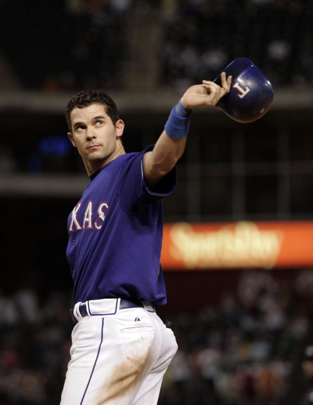 FILE - In this Sept. 16, 2006, file photo, Texas Rangers' Michael Young acknowledges cheers from fans after hitting an RBI single in the seventh inning off Los Angeles Angels pitcher Chris Bootcheck for his 200th hit of the season, in a baseball game in Arlington, Texas. Before moving across the street next season into a $1 billion-plus air-conditioned stadium with a retractable roof, the Rangers have three games this week against the Boston Red Sox and then end the season with three games against the AL East champion New York Yankees. (AP Photo/Tony Gutierrez, File)