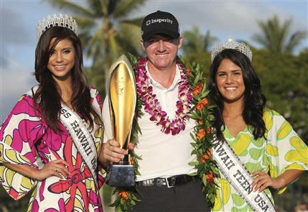 Walker celebrates with Hara and Gosling after winning the final round of the Sony Open golf tournament at Waialae Country Club in Honolulu