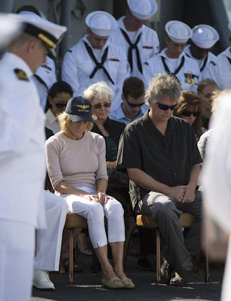 "Carol Armstrong, wife of Neil Armstrong, Eric ""Rick"" Armstrong, son of Neil Armstrong, and other family members bow their heads during the Armstrong burial at sea service aboard the USS Philippine Sea (CG 58), Friday, Sept. 14, 2012, in the Atlantic Ocean. Armstrong, who died last month in Ohio at age 82, walked on the moon in July 1969. (AP Photo/NASA, Bill Ingalls)"