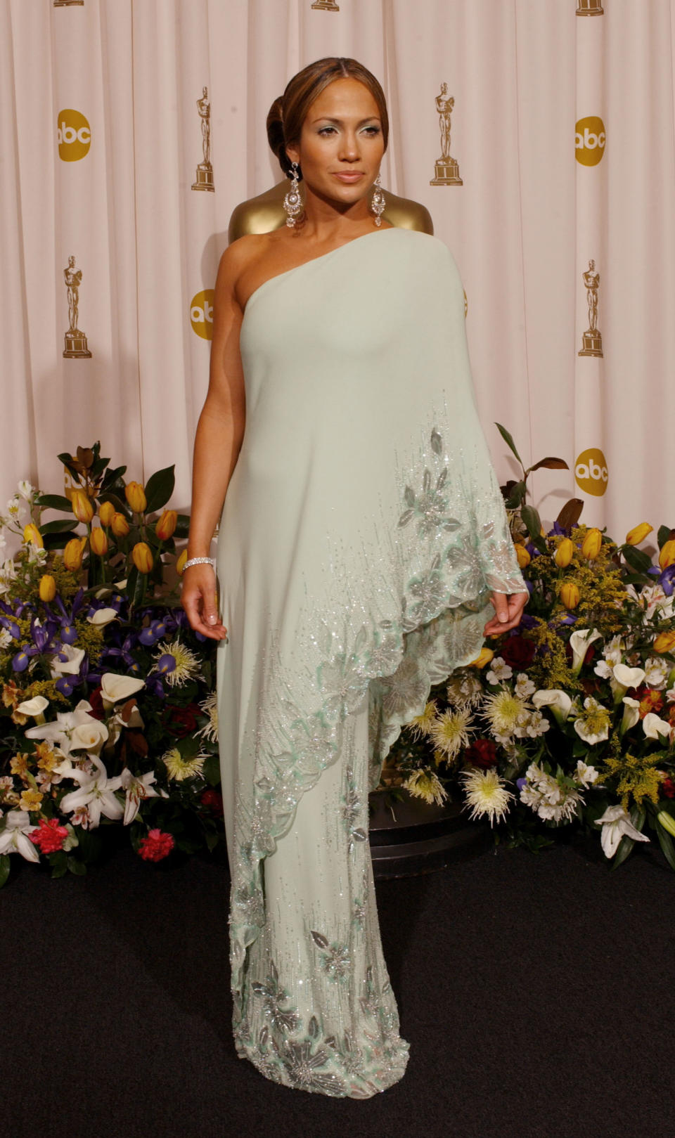 <p>Lopez and then-fiancé Ben Affleck were the hottest couple in Hollywood at the 2003 Academy Awards. With all eyes on Bennifer, Lopez wowed in vintage mint-green sari style gown inspired by a look previously worn by her style icon, Jackie Kennedy Onassis.</p>
