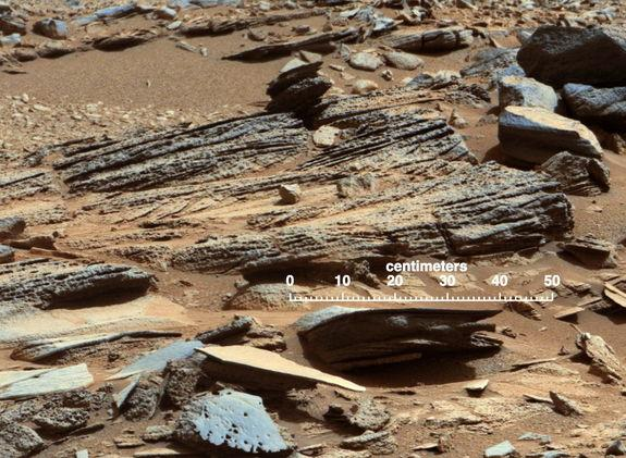 "This image from the Mast Camera (Mastcam) on NASA's Mars rover Curiosity shows inclined layering known as cross-bedding in an outcrop called ""Shaler"" on a scale of a few tenths of meters, or decimeters (1 decimeter is nearly 4 inches). Image re"
