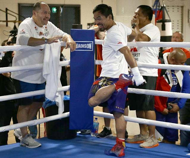 Manny Pacquiao's conditioning coach, Justin Fortune (L) is a former heavyweight who fought off throat cancer. (AFP Photo/Tertius PICKARD)