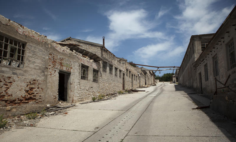 In this photo taken June 28, 2012, ruined prison buildings are seen at the Adriatic island of Goli Otok. The prison island housed up to 16,000 political prisoners over an eight-year period. They ended up there after being accused by Tito's regime of expressing sympathy toward Josef Stalin and his hardline Soviet dictatorship. (AP Photo/Darko Bandic)