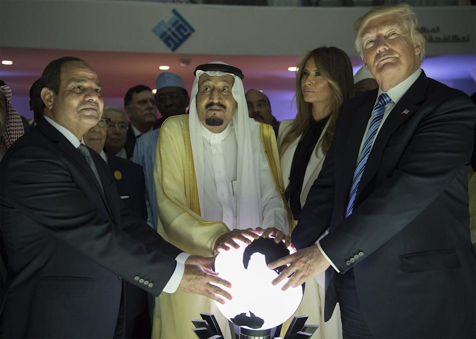 Trump, along with first lady Melania Trump, Saudi Arabia's King Salman bin Abdulaziz al-Saud and Egyptian President Abdel Fattah el-Sisi, put their hands on an illuminated globe during the inauguration ceremony of the Global Center for Combating Extremist Ideology in Riyadh, Saudi Arabia, on May 21.