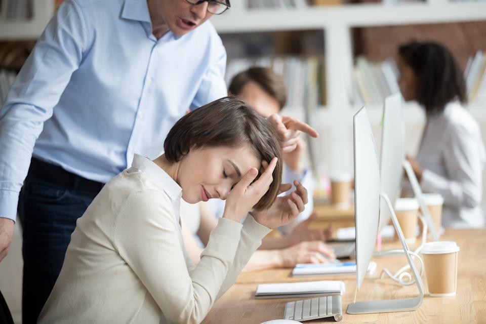 Angry irritated company boss reprimanding employee female, accusing of serious mistake and bad work. Young crying woman worker listening yelling from executive manager feels guilty frustrated unhappy