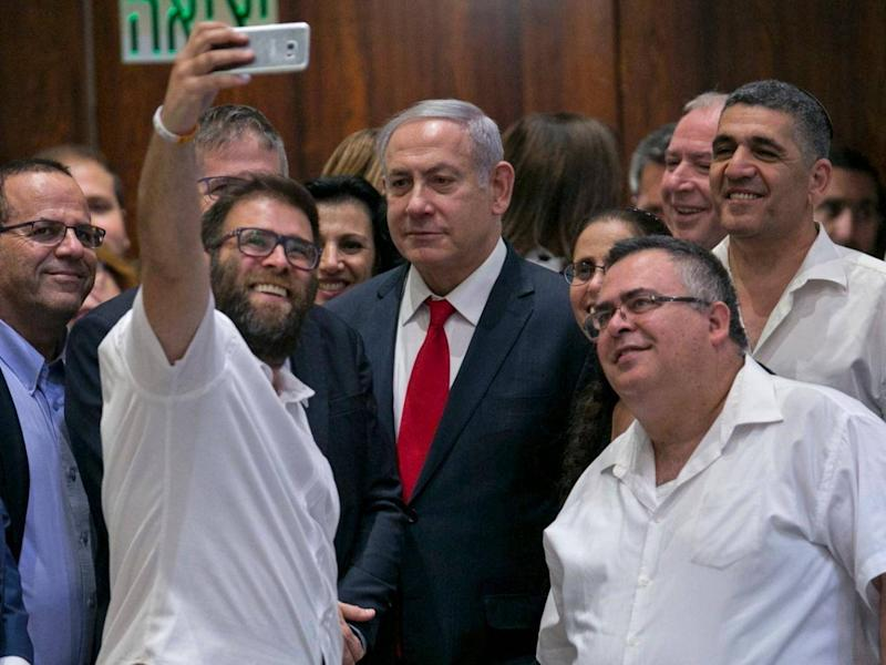 Knesset member Oren Hazan takes a selfie with Israel's Prime Minister Benjamin Netanyahu after the session (AP)