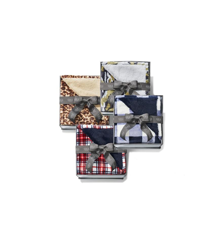 """<p>If you cozy up on your couch with one of these plush throws with a faux-fur backing, there's a good chance you may never get up again.</p><p><em>$45 each at <a href=""""https://www.qvc.com/"""" target=""""_blank"""">www.qvc.com</a></em></p><p>OR:</p><p><a class=""""body-btn-link"""" href=""""https://www.amazon.com/dp/B07YSW5C34?tag=syn-yahoo-20&ascsubtag=%5Bartid%7C10072.g.29700361%5Bsrc%7Cyahoo-us"""" target=""""_blank"""">Shop Amazon</a></p>"""
