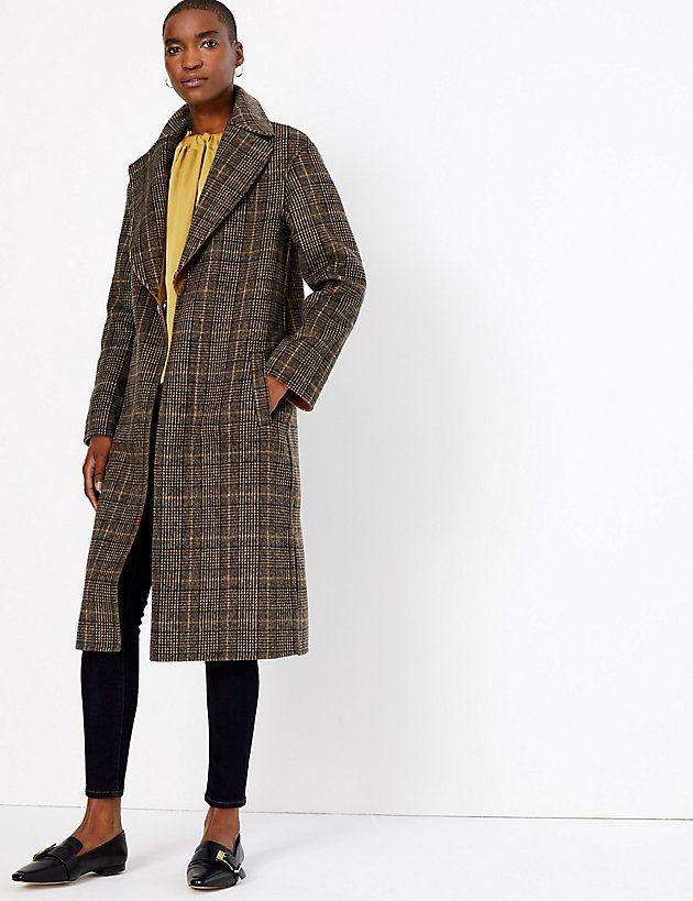 "<p>Wool checked reversible overcoat, £129</p><p><a class=""body-btn-link"" href=""https://go.redirectingat.com?id=127X1599956&url=https%3A%2F%2Fwww.marksandspencer.com%2Fwool-checked-reversible-overcoat%2Fp%2Fp60276616%3Fcolor%3DLIGHTTANMIX&sref=http%3A%2F%2Fwww.cosmopolitan.com%2Fuk%2Ffashion%2Fstyle%2Fg22863371%2Fmarks-and-spencer-coats%2F"" target=""_blank"">BUY NOW</a></p><p>We are all for a coat that works twice as hard and the reversible check and camel colourways are both as chic as each other. Perfect for the indecisives amongst us. Plus M&S are kindly considering our tiny flat's even tinier storage space. <br></p>"