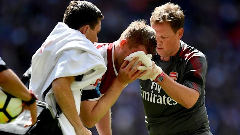 Chelsea captain Cahill apologises to Mertesacker after leaving Arsenal man requiring stitches