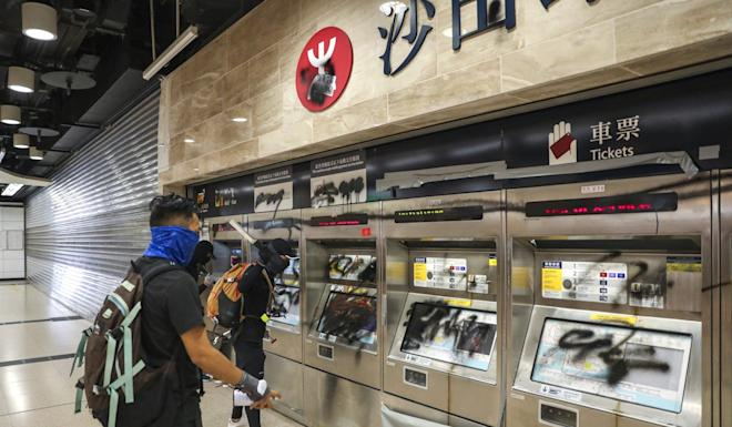 Anti-government protesters vandalise the Sha Tin MTR station on September 22. Photo: Sam Tsang