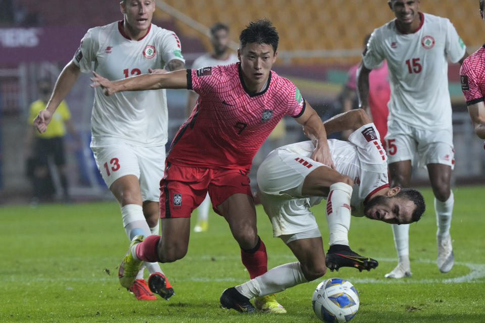 Lebanon's Abbas Assi, right, fights for the ball with South Korea's Cho Gue-sung during the final round of the Asian zone group A qualifying soccer match for the FIFA World Cup Qatar 2022 at Suwon World Cup stadium in Suwon, South Korea, Tuesday, Sept. 7, 2021. (AP Photo/Ahn Young-joon)