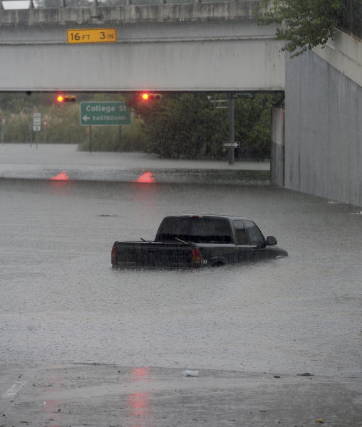 A truck is submergedd in floodwaters on MLK north of College Street in Beaumont where several roads remained heavily flooded throughout the afternoon. Boaters and other emergency personnel were conducting rescue missions to those in need throughout the morning and afternoon, Thursday, September 19, 2019. (Kim Brent/The Beaumont Enterprise via AP)
