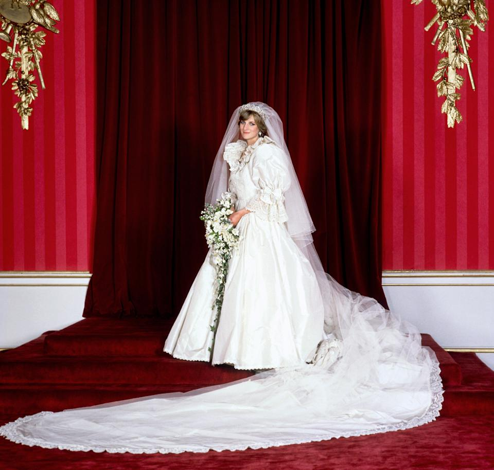 The Princess of Wales in her bridal gown at Buckingham Palace after her marriage to Prince Charles at St. Paul's Cathedral (PA Archive)