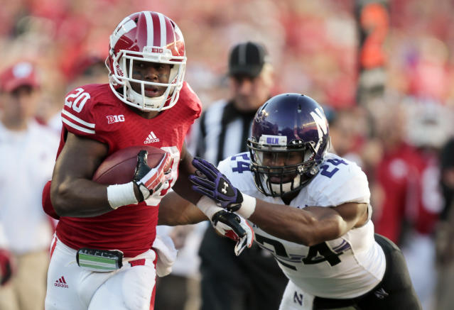 Wisconsin running back James White (20) outruns Northwestern safety Ibraheim Campbell (24) during the second half of an NCAA college football game in Madison, Wis., Saturday, Oct. 12, 2013. Wisconsin upset Northwestern 35-6. (AP Photo/Andy Manis)