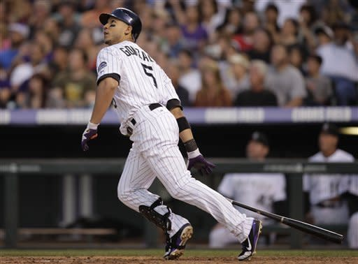 Colorado Rockies' Carlos Gonzalez hits a double against the Houston Astros in the fourth inning of a baseball game on Thursday, May 31, 2012, in Denver. (AP Photo/Joe Mahoney)