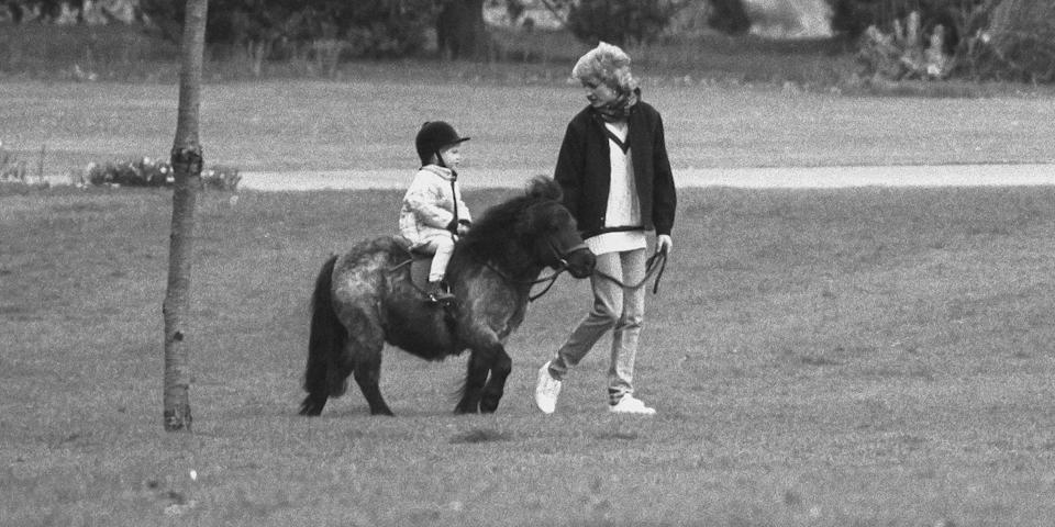 <p>Teaching Prince Harry how to ride a pony during Easter Weekend at Windsor Castle.</p>