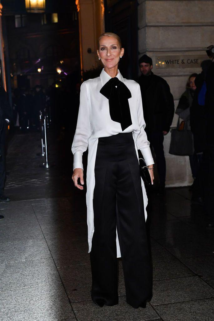 <p>You simply can't go wrong with a black and white ensemble. During Paris Fashion Week, the singer wore a pussy bow blouse with wide leg trousers, a sleek black clutch, and pearl earrings.</p>