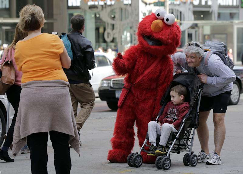 Cookie Monster, Elmo get in Times Square trouble