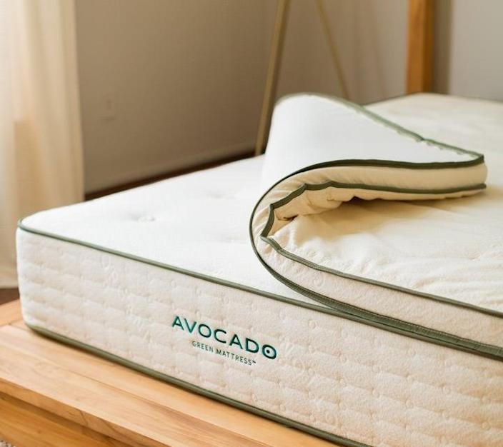 "<h3>Avocado Mattress</h3><strong>Deal: Save $100 on select mattresses</strong><br><strong>Code: GREEN100</strong><br><br>This green-bedding brand specializes in handmade-in-California mattresses that are crafted from premium natural, non-toxic, and organic materials. Each product comes eco-approved with a GREENGUARD Gold certification by UL Environment for low emissions — and 1% of all revenue is donated to non-profit organizations with a focus on sustainability. <br><br><em>Shop <strong><a href=""https://www.avocadogreenmattress.com/"" rel=""nofollow noopener"" target=""_blank"" data-ylk=""slk:Avocado Mattress"" class=""link rapid-noclick-resp"">Avocado Mattress</a></strong></em><br><br><strong>Avocado</strong> Green Mattress Topper, $, available at <a href=""https://go.skimresources.com/?id=30283X879131&url=https%3A%2F%2Fwww.avocadogreenmattress.com%2Fshop%2Fmattress-topper"" rel=""nofollow noopener"" target=""_blank"" data-ylk=""slk:Avocado"" class=""link rapid-noclick-resp"">Avocado</a>"