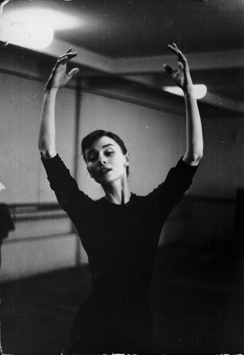 """<p>Suddenly the gracefulness of Audrey Hepburn makes sense. The <em>Breakfast at Tiffany's </em>actress took up ballet during World War II when her family fled to the Netherlands. Audrey trained at the Arnhem Conservatory and was the """"<a href=""""https://www.vintag.es/2018/12/audrey-hepburn-ballet-dancing.html"""" rel=""""nofollow noopener"""" target=""""_blank"""" data-ylk=""""slk:star pupil"""" class=""""link rapid-noclick-resp"""">star pupil</a>."""" After that, she became a student of Dutch ballerina Sonia Gaskell. </p><p>When her family moved to London in 1948, she was offered a spot at Ballet Rambert only to be told her height and physique was not suitable for a career as a professional ballerina.</p>"""