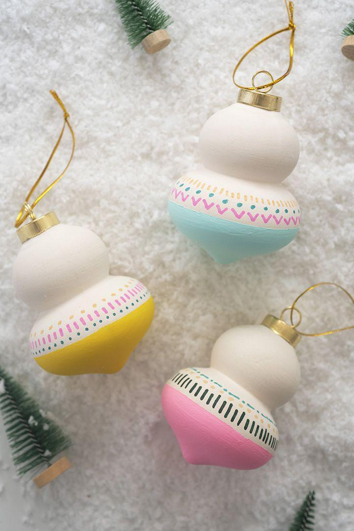 """<p>To draw more precise designs on unfinished ornaments, use paint pens instead of acrylics and a brush. </p><p><em>Get the tutorial at <a href=""""https://www.aliceandlois.com/13061-2/"""" rel=""""nofollow noopener"""" target=""""_blank"""" data-ylk=""""slk:Alice and Lois"""" class=""""link rapid-noclick-resp"""">Alice and Lois</a>.</em></p><p><a class=""""link rapid-noclick-resp"""" href=""""https://www.amazon.com/Acrylic-Paintigo-Markers-Porcelain-Painting/dp/B087CDP6QY?tag=syn-yahoo-20&ascsubtag=%5Bartid%7C10072.g.34443405%5Bsrc%7Cyahoo-us"""" rel=""""nofollow noopener"""" target=""""_blank"""" data-ylk=""""slk:SHOP PAINT PENS"""">SHOP PAINT PENS</a></p>"""