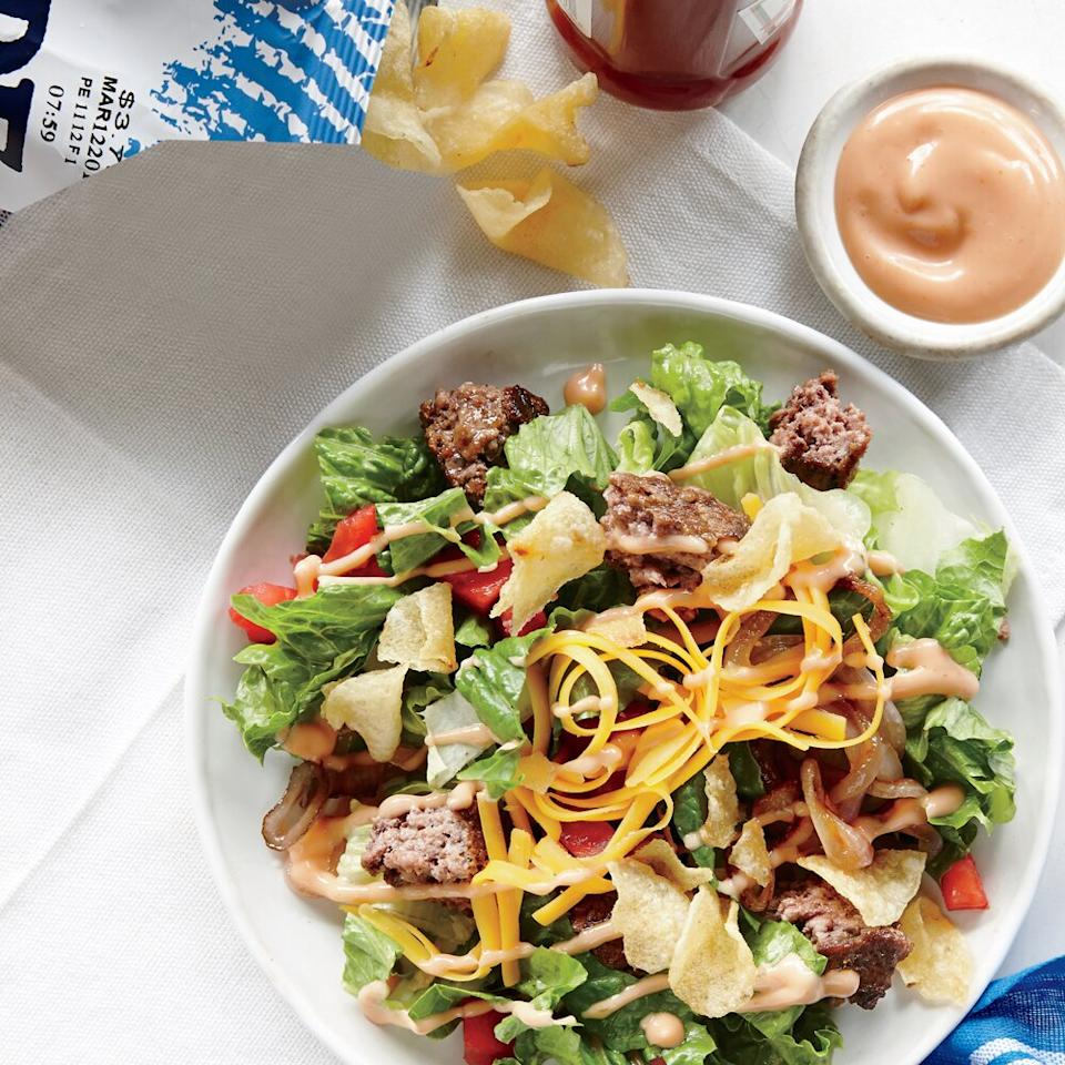 """<p>Classic burger elements become a fast, fun salad--a deconstructed take on a diner favorite. Instead of four burger patties, we cook just two, then chop and sprinkle them over the top. A handful of crushed potato chips adds crunch. Kick up the dressing with a pinch of ground red pepper.</p> <p><a href=""""https://www.myrecipes.com/recipe/the-cheeseburger-salad"""">The Cheeseburger Salad Recipe</a></p>"""