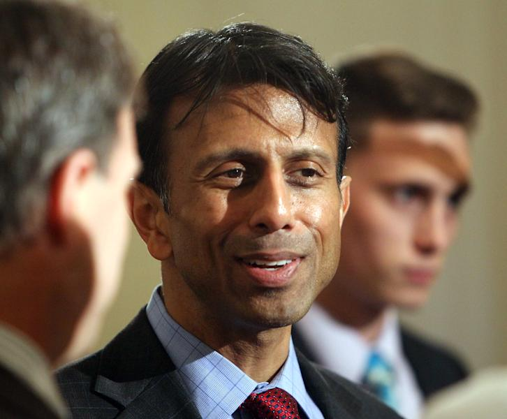 Louisana Governor Bobby Jindal talks with Republican activists at a Republican fundraiser Friday, May 10, 2013 in Manchester, N.H. Jindal became the first potential 2016 presidential candidate this year to visit New Hampshire, unofficially kicking off the state's presidential primary season roughly 2O years before voting begins. (AP Photo/Jim Cole)