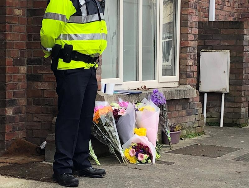 Flowers outside a house in the village of Newcastle, south west of Dublin city where three children were found dead on Friday (Picture: PA0