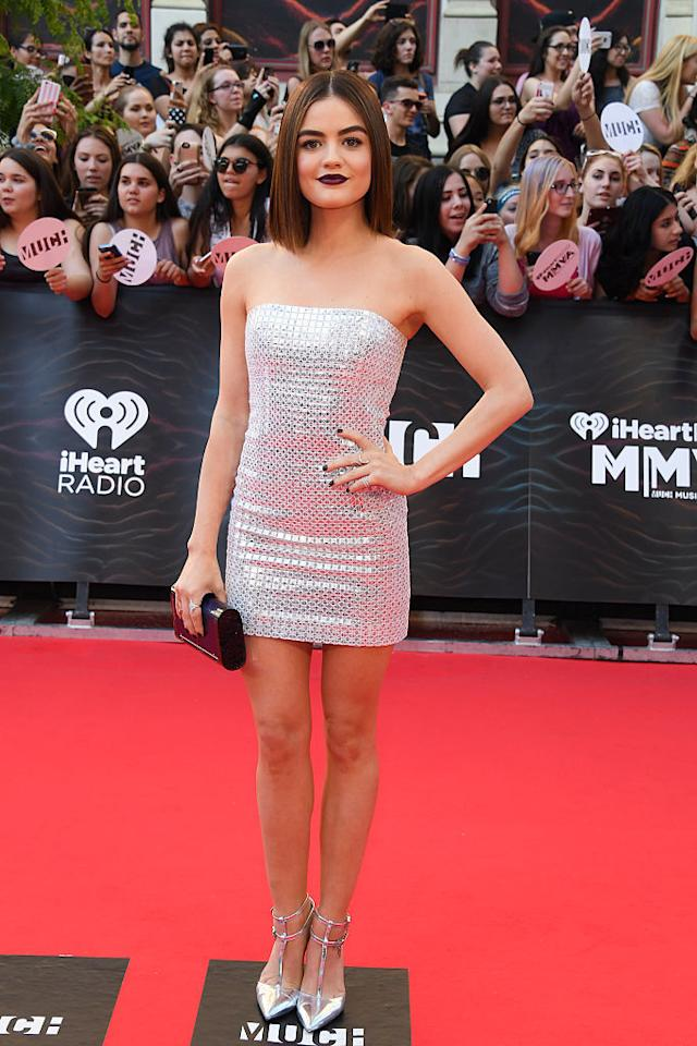 "<p>The ""Pretty Little Liars"" star looked like a disco ball – in the best way possible. Hale stunned in a curve-hugging silver mini dress with matching shoes. And her dark lipstick? On point. <i>(Photo by George Pimentel/WireImage)</i><br /></p>"