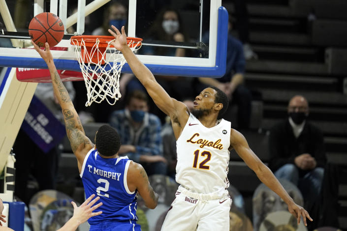 Drake forward Tremell Murphy (2) drives to the basket ahead of Loyola of Chicago guard Marquise Kennedy (12) during the first half of an NCAA college basketball game, Sunday, Feb. 14, 2021, in Des Moines, Iowa. (AP Photo/Charlie Neibergall)
