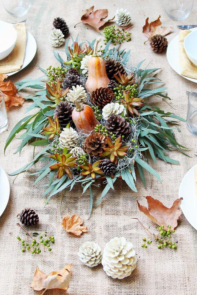 "<p>Lean on the natural beauty of the season — pinecones, gourds, and mossy greens — for a refreshing take on a standard floral bouquet. </p><p><em><a href=""https://www.apieceofrainbow.com/diy-thanksgiving-table-decoration-centerpiece/"" rel=""nofollow noopener"" target=""_blank"" data-ylk=""slk:Get the tutorial at A Piece of Rainbow »"" class=""link rapid-noclick-resp"">Get the tutorial at A Piece of Rainbow »</a></em></p>"