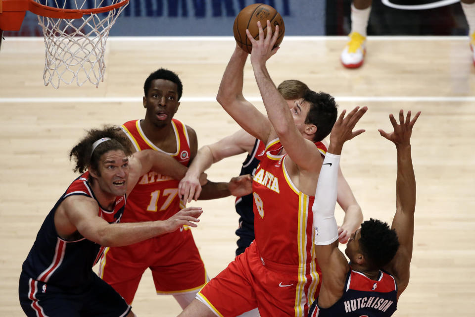 Atlanta Hawks forward Danilo Gallinari (8) takes it to the basket during the first half of an NBA basketball game against the Washington Wizards Wednesday, May 12, 2021, in Atlanta. (AP Photo/Butch Dill)