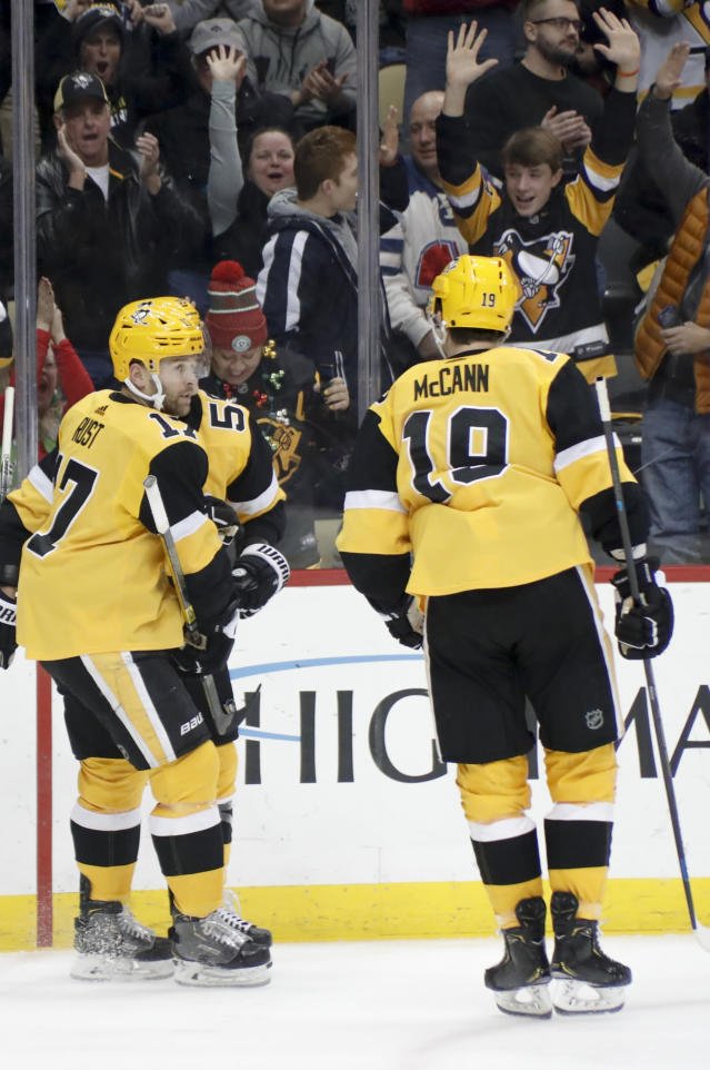 Fans and teammates celebrate with Pittsburgh Penguins' Bryan Rust, left, after he scored his first goal of the second period against the Los Angeles Kings in an NHL hockey game, Saturday, Dec. 14, 2019, in Pittsburgh. (AP Photo/Keith Srakocic)