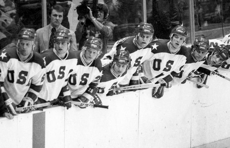 "In this Feb. 22, 1980, photo, United States coach Herb Books and players look to the action on the ice during a medal-round game against the Soviet Union at the Winter Olympics in Lake Placid, N.Y. Tourism is a $1.2 billion industry in the Lake Placid region, much of it still fueled by the memory of the U.S. hockey team beating the Soviet Union as the ""Miracle on Ice"" highlight of the 1980 Olympic Games. (Tom Sweeney/Star Tribune via AP)"