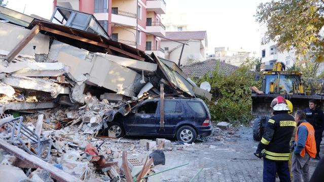 Rescue crews used excavators to search for survivors trapped in toppled apartment buildings in Albania. (Photo: Hektor Pustina/AP)