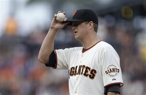 San Francisco Giants' Matt Cain adjusts his cap in the first inning of a baseball game against the Los Angeles Dodgers, Sunday, May 5, 2013, in San Francisco. (AP Photo/Ben Margot)