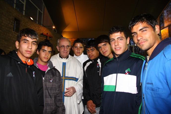 In this March 24, 2011 photo released by the San Lorenzo de Almagro soccer team, Argentina's Cardinal Jorge Bergoglio, third from left, poses with young players of the San Lorenzo soccer team inside the soccer club's chapel in Buenos Aires, Argentina. Bergoglio, a San Lorenzo soccer fan, was chosen as Pope on March 13, 2013, the first pope ever from the Americas and the first from outside Europe in more than a millennium. (AP Photo/Club Atletico San Lorenzo de Almagro)