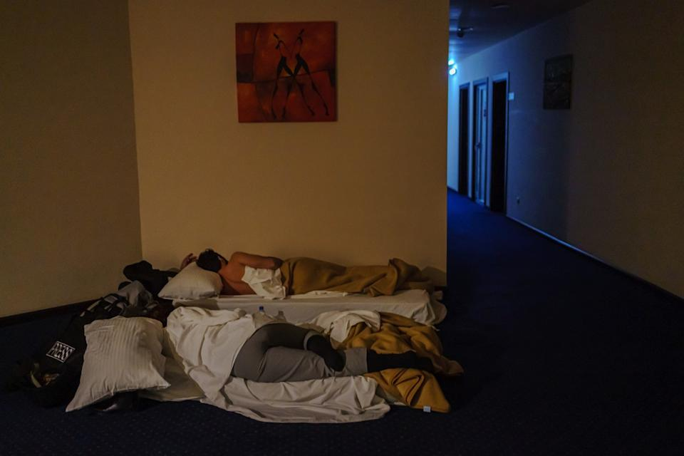 Guests at a hotel in Stepanakert, Nagorno-Karabakh, sleep in a hallway to avoid shrapnel and debris.