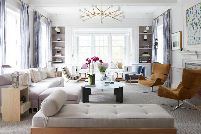 """The family room """"is ethereal with windows at three walls, affording remarkable natural light,"""" Newman comments. Interestingly, the space does not include a television."""