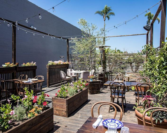 """While some restaurants purchased temporary plastic igloos or tents, others added permanent outdoor dining spaces, like two of these """"parklets"""" seating 60 at San Diego's Cesarina."""