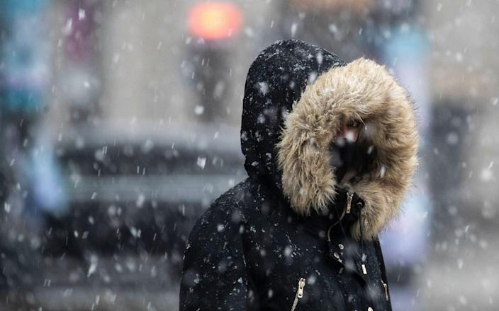 Mandatory Credit: Photo by HAYOUNG JEON/EPA-EFE/Shutterstock (11716468e) A woman wearing a face mask takes a walk in the falling snow in Berlin, Germany, 19 January 2021. German Chancellor Angela Merkel will meet on 19 January afternoon at the chancellery with the federal state premiers to discuss an extension of the current lockdown in an attempt to rein the coronavirus disease (COVID-19) pandemic in the country. Germany discusses to extend coronavirus lockdown, Berlin - 19 Jan 2021 - HAYOUNG JEON/EPA-EFE/Shutterstock