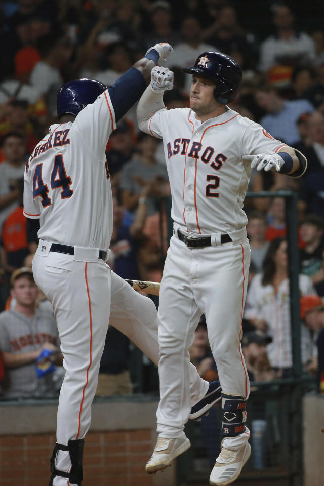 Houston Astros' Alex Bregman, right, celebrates his two-run home run off Detroit Tigers pitcher Jordan Zimmerman with on-deck batter Yordan Alvarez in the fourth inning of a baseball game Thursday, Aug. 22, 2019, in Houston. (AP Photo/Richard Carson)