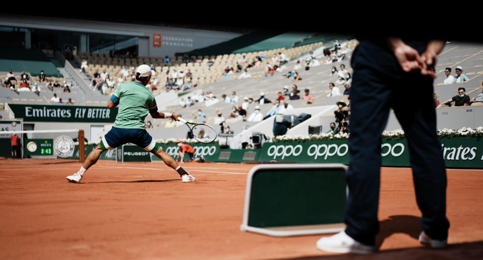 Japan's Kei Nishikori plays a return to Russia's Karen Khachanov during their second round match on day four of the French Open tennis tournament at Roland Garros in Paris, France, Wednesday, June 2, 2021. (AP Photo/Thibault Camus)