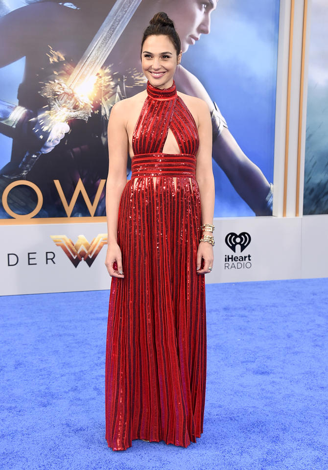 "<p>The stylish Gadot explained at <i>Wonder Woman</i>'s Hollywood premiere, where she went glam in a Gucci number and $50 flats from Aldo, that she'd given up her high heels for a very simple reason. ""<a rel=""nofollow"" href=""https://ec.yimg.com/ec?url=http%3a%2f%2fpeople.com%2fstyle%2fgal-gadot-wears-flats-wonder-woman-press-tour%2f%26quot%3b%26gt%3bIt%e2%80%99s&t=1524189826&sig=RsLfs3i7TadO7yLXdrkX4A--~D more comfortable</a>. That's it!"" she told <i>People</i>. (Photo: Jordan Strauss/Invision/AP) </p>"