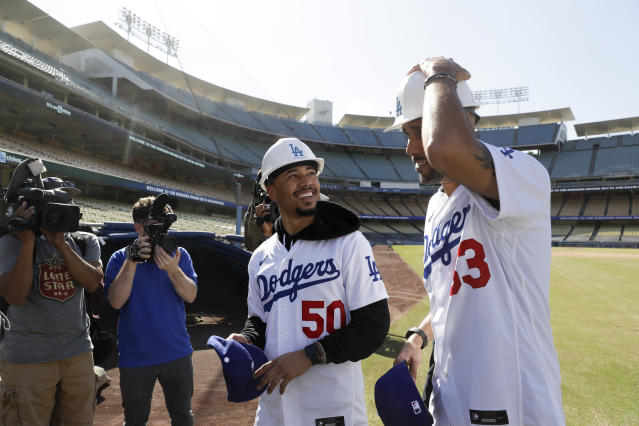 New Los Angeles Dodgers players David Price, right, and Mookie Betts tour Dodger Stadium after a news conference in Los Angeles, Wednesday, Feb. 12, 2020. (AP Photo/Chris Carlson)