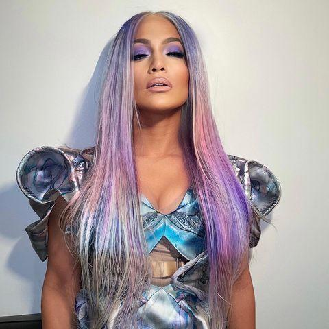 """<p>After a whirlwind of seemingly never ending hair transformations, J Lo has gifted us with the best Christmas present of 2020 - her with unicorn purple hair. The singer turned to A-list hairstylist Chris Appleton for her XXL poker straight cosmic purple extensions that perfectly matched her galactic lavender eye make-up and sci-fi costume. Appleton captioned the look, 'Unicorn Barbie 🦄'.</p><p><a href=""""https://www.instagram.com/p/CJPaXNzha9C/?utm_source=ig_embed&utm_campaign=loading"""" rel=""""nofollow noopener"""" target=""""_blank"""" data-ylk=""""slk:See the original post on Instagram"""" class=""""link rapid-noclick-resp"""">See the original post on Instagram</a></p>"""