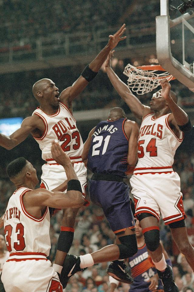 Horace Grant (right) and Michael Jordan rise up on defense for the Chicago Bulls.