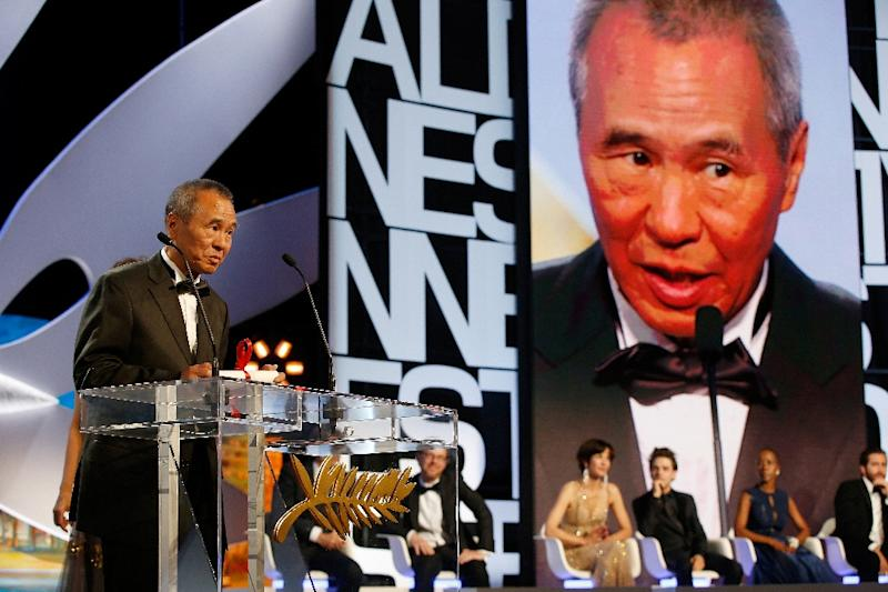 Taiwanese director Hou Hsiao-Hsien talks on stage after being awarded with the Best Director prize during the closing ceremony of the 68th Cannes Film Festival in Cannes, France, on May 24, 2015 (AFP Photo/Valery Hache)