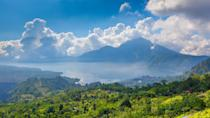"""<p><strong>What's this place all about?</strong><br> On an island full of natural beauty, Mount Batur (or """"Gunung Batur"""") and its serene surroundings might be the most dramatic destination of all. The 5,600-foot volcanic marvel contains Bali's largest crater lake—a splendid cycling site and slopes ripe for hiking with picturesque villages along the way.</p> <p><strong>Anything we should be sure to see?</strong><br> The sunrise, as seen from the peak, is spectacular. Not for the faint of heart—or anyone who loathes early-morning wake-up calls—the ascent takes around two hours. But once you've reached the top, you might witness one of the most majestic mist-sheathed vistas you've ever seen.</p> <p><strong>Is it easy to navigate?</strong><br> You can trek the volcano alone, but the lack of signage means you'll constantly have to ask for directions. We recommend booking a tour or hiring a local guide—just be sure to vet them. If trekking is too strenuous, head to one of the many traditional villages for volcanic panoramas.</p> <p><strong>Why should we make the time for this?</strong><br> Hiking—or simply seeing—Mount Batur is an essential Bali to-do. Be vigilant about monitoring the news and local alerts about possible <a href=""""https://www.cntraveler.com/story/why-people-seek-out-volcanoes?mbid=synd_yahoo_rss"""" rel=""""nofollow noopener"""" target=""""_blank"""" data-ylk=""""slk:volcanic activity"""" class=""""link rapid-noclick-resp"""">volcanic activity</a>. If you want a better chance of reaching the peak without thick clouds obscuring the view, avoid the rainy season.</p>"""